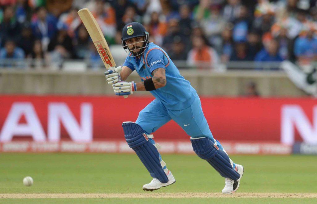 Kohli, Yuvraj lift India to 319-3