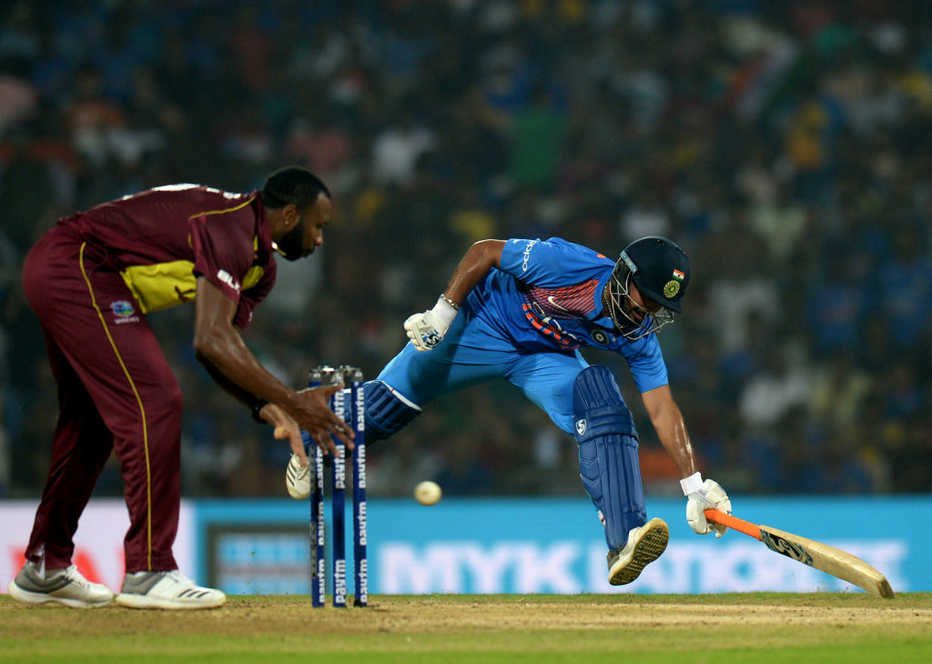 India steal final ball single to down Windies