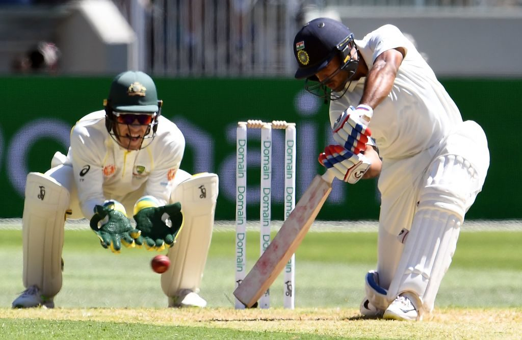 India grind out healthy start on Boxing Day