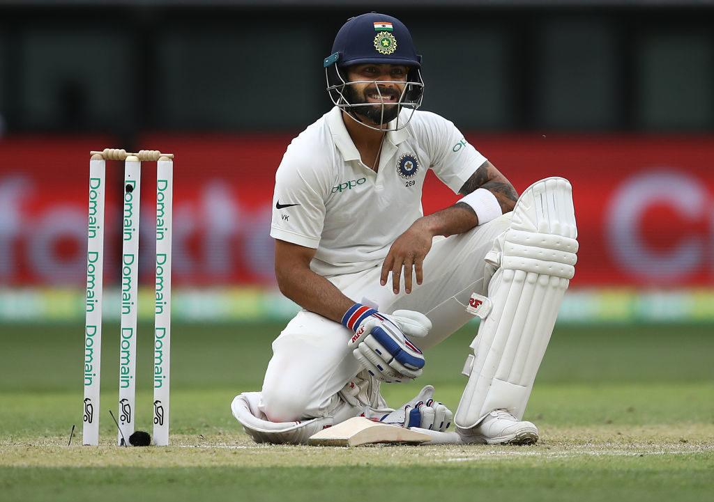 Kohli guides India through tough day